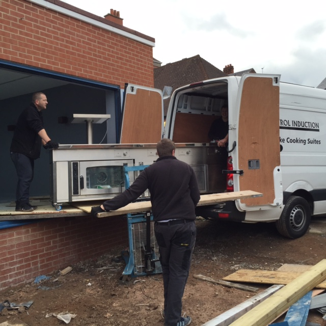 Commercial induction suite delivery van at Harborne