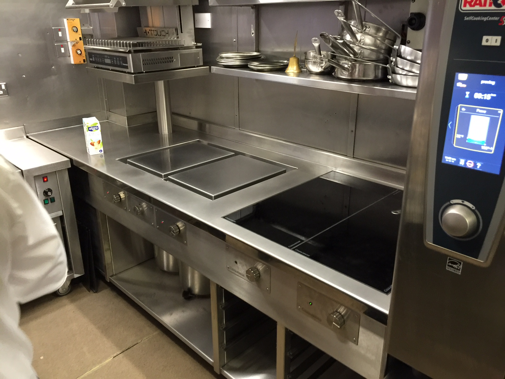 Finished induction cooking suite next to combi oven