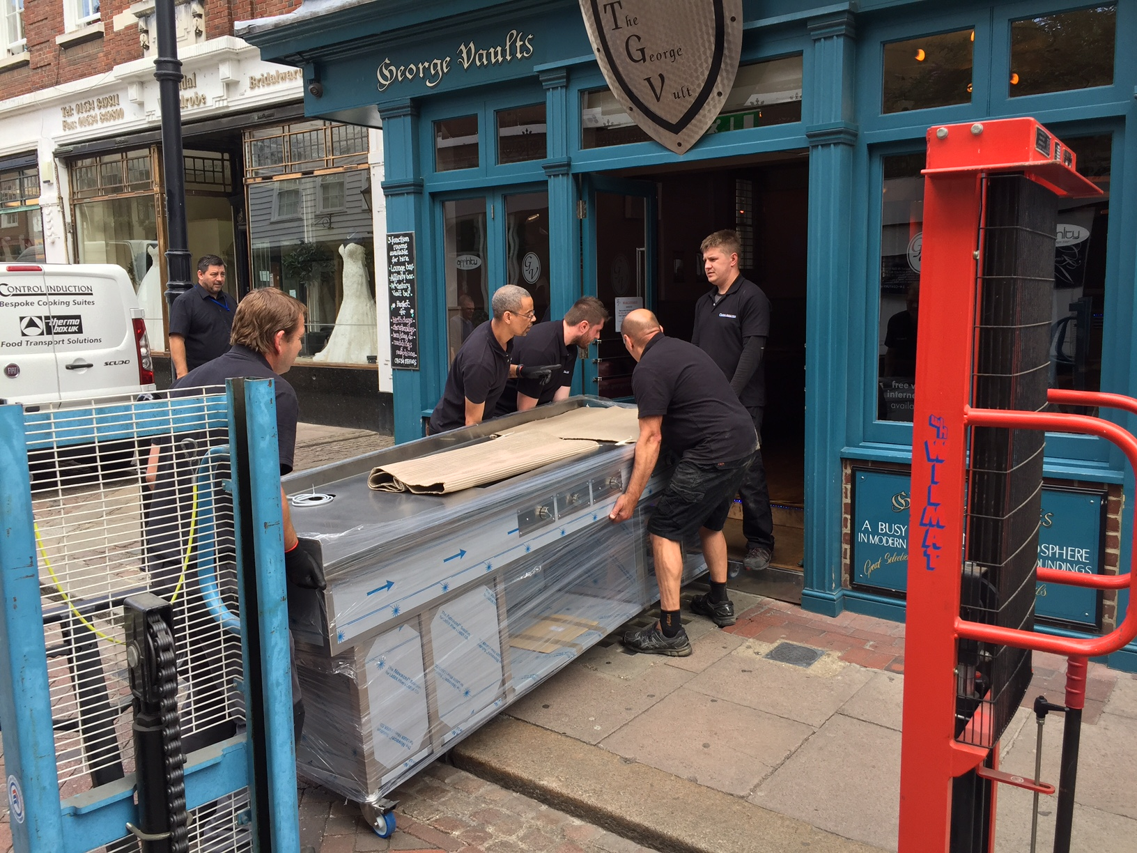 Induction cooker unloaded and being wheeled into the restaurant