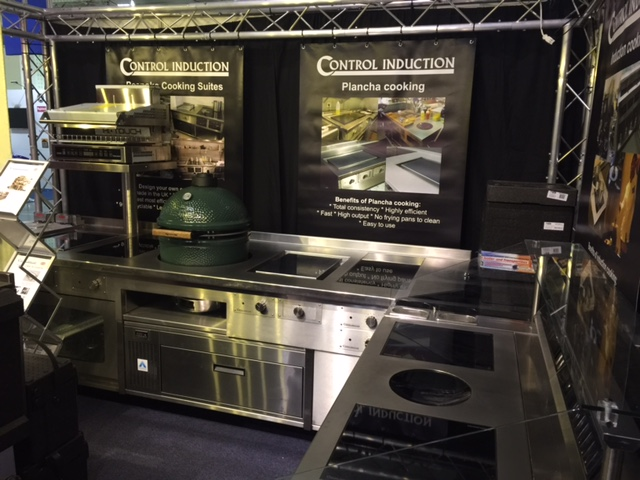 Induction stove with planchas salamander grill slider and green egg